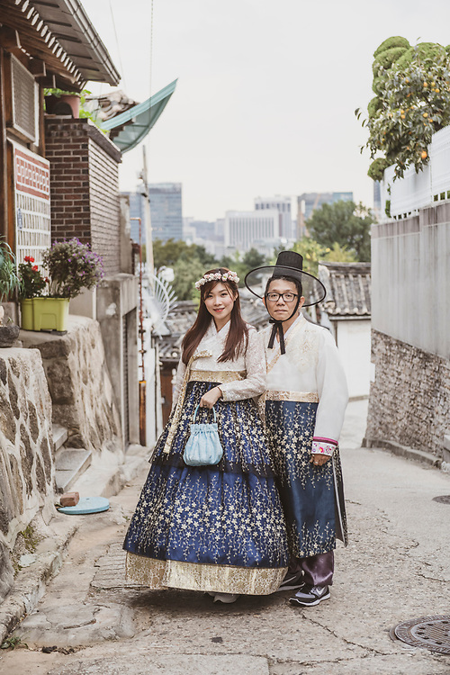 A Korean couple walking in Seoul's Bukchon Hanok Village wear hanbok, traditional Korean clothing, which can be rented for day use. (September 27, 2019)