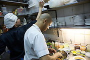 © Clay Williams / http://claywilliamsphoto.com. In the kitchen with Mychael Henry, chef of Poke, a Pan-Asian pop-up at Magdalena's Party, a bar in Palermo Soho.<br /> <br /> Buenos Aires, Argentina. 2012