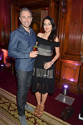 """YASMIN MILLS and MARK NEWNS at the presentation of Le Prix Champagne De La Joie de Vivre to Stephen Webster in celebration of his long standing contribution to """"Joie de Vivre' held at the Council Room, One Great George Street, London on 22nd April 2015."""