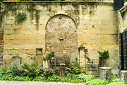 A old wall at the entrance to The Giardino Giusti Gardens in Verona. The gardens are one of the finest Renaissance gardens in Europe and were planted in 1580. They are amed after the noble family that has tended them since opening them to the public in 1591. The vegetation is an Italianate mix of the manicured and natural, graced by soaring cypresses, one of which the German poet Goethe immortalised in his travel writings.
