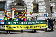 XR Roads Rebellion activists protest outside the Treasury against the UK governments £27.4bn roads programme on 21st October 2021 in London, United Kingdom. Environmental activists from groups including Extinction Rebellion argue that plans by the government to build new trunk roads are inconsistent with the UKs climate commitments and should be cancelled in the Autumn Spending Review.