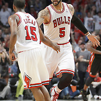 14 March 2012: Chicago Bulls power forward Carlos Boozer (5) congratulates Chicago Bulls point guard John Lucas (15) during the Chicago Bulls 106-102 victory over the Miami Heat at the United Center, Chicago, Illinois, USA.