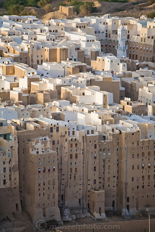 """An aerial view of the town of Shibam, in the Hadhramawt Valley, Yemen. Shibam is a World Heritage Site. The old walled city with it's talk mud brick buildings has been called 'the Manhattan of the desert""""."""