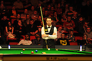 Judd Trump of England during his match against  John Higgins of Scotland. Bet Victor Welsh open snooker at the Newport centre in Newport, South Wales on Thursday 27th Feb 2014.<br /> pic by Andrew Orchard, Andrew Orchard sports photography.