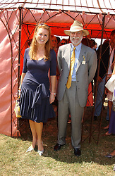 SARAH, DUCHESS OF YORK and VISCOUNT COWDRAY at the Veuve Clicquot sponsored Gold Cup Final or the British Open Polo Championship held at Cowdray Park, West Sussex on 17th July 2005.<br />