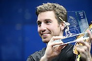 Mathieu Castagnet of France lifts the Canary Wharf Classic Trophy after winning the final.the Final, Omar Mosaad of Egypt v Mathieu Castagnet of France , Canary Wharf Squash Classic 2016 , at the East Wintergarden in Canary Wharf , London on Friday 11th March 2016.<br /> pic by John Patrick Fletcher, Andrew Orchard sports photography.