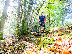 Man hiking in the Black Forest on narrow footpath near Yach, Elzach, Baden-Wuerttemerg, Germany