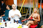 Albania's Socialist Party leader Edi Rama (L) Sits next to Kosovo Albanian pop-star singer Vesa Luma (R) during a electoral campaign rally ahead of the upcoming general election in Tirana, Albania on Sunday, June 21, 2009. Albanians will vote in the legislative elections on 28 June. (Photo by Vudi Xhymshiti)