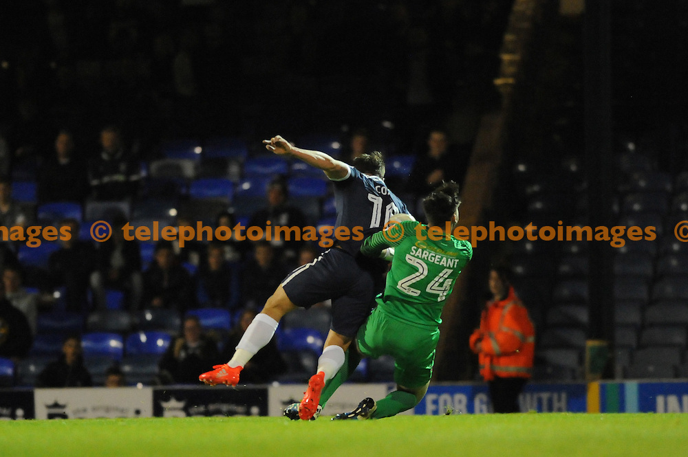 Southends Simon Cox and Leyton Orients Sam Sargeant in action during the Checkatrade Trophy match between Southend United and Leyton Orient at Roots Hall in Southend. October 11, 2016.<br />Holly  Allison / Telephoto Images<br />+44 7967 642437