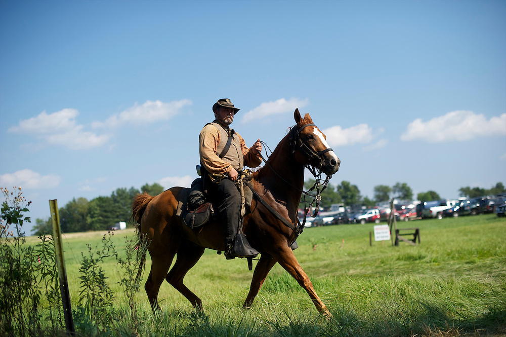 A member of the cavalry makes his way to the battlefield during the 149th Gettysburg Reenactment in Gettysburg, Pennsylvania on July 6, 2012.