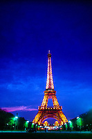 he Eiffel Tower seen from the Champ de Mars (park), Paris, France