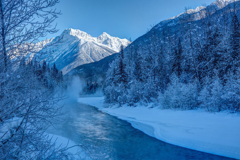 Canada's British Columbia is absolutely beautiful in wintertime. This view of the Illecillewaet River looking eastward towards the incredible rocky peaks of Rogers Pass was taken on a bitterly cold January morning, just north of Revelstoke, BC.