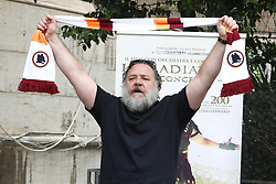 """Rome, photocall theater show """"Il Gladiatore in concerto"""". In the picture: Russel Crowe with the scarf of the football team AS Roma"""