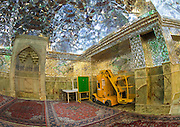 Stunning photographs reveal the beautiful ceilings in Iran's mosques, bazaars and public baths<br /> <br /> For the past few decades, restrictions on travel to Iran has meant the country has been largely shut off from the Western world, butas visa sanctions are lifted in the light of a landmark nuclear deal, the local tourism industry is hoping for a flurry of visitors.<br /> It's not hard to see why Iran is listed as one of the top travel destinations of 2016, with its rich culture and history.<br /> Among the standout aspects of the nation is its beautiful ancient architecture, with the cities and towns littered withornate and eye-catching mosques, public baths and markets.<br /> And unlike many other countries - the roof is not an afterthought, with many ceilings built as the centrepiece to the building, with many of the tile designs showcasing a display of intricate geometric patternsthatdate back several centuries.<br /> French photographerEric Lafforgue has travelled the country photographing the ceilings of indoor markets, mosques and bath houses.<br /> <br /> Photo shows: In the Shah-e-cheragh Mausoleum an elevator chair is used to clean the mosaic glasses