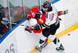 Nejc Kozar of Jesenice vs Jake Laplante of Olimpija during ice hockey game between Team Jesenice and HDD Telemach Olimpija in 1st leg of Finals of Slovenian National Championship 2014, on March 31, 2014 in Arena Podmezakla, Jesenice, Slovenia. Photo by Vid Ponikvar / Sportida