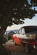 A vintage American car is parked beeside the Caribbean Sea in La Boca, a small community several kilometers from the inland town of Trinidad, Cuba. (December 6, 2014)