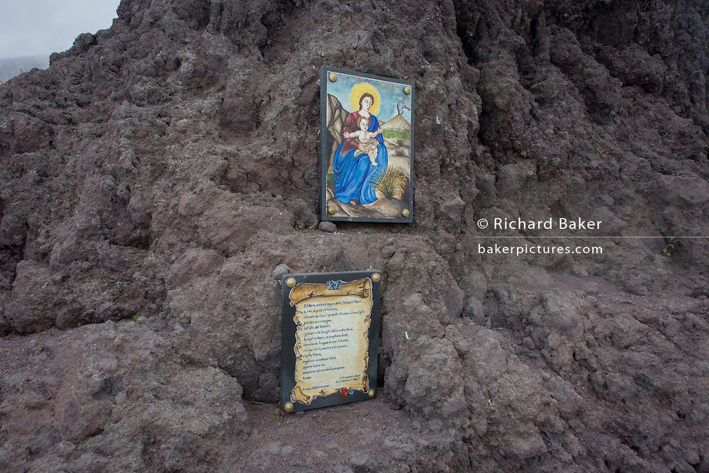 Religious shrine and old lava on the crater edge of Vesuvius volcano, Italy.