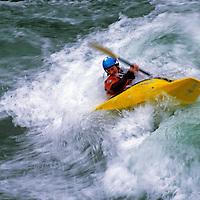 A kayaker plays in waves on the Kananaskis River, near Calgary.