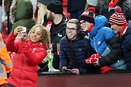 Selfie time for the lads with the players during the FA Women's Super League match between Liverpool Women and Everton Women at Anfield, Liverpool, England on 17 November 2019.