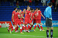 Wales players inc Ashley Williams (c) celebrate after Aaron Ramsey scores his sides 2nd goal. Euro 2012 Qualifying match, Wales v Montenegro at the Cardiff City Stadium in Cardiff  on Friday 2nd Sept 2011. Pic By  Andrew Orchard, Andrew Orchard sports photography,