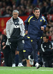 """Manchester United manager Jose Mourinho and Burton Albion manager Nigel Clough on the touchline during the Carabao Cup, Third Round match at Old Trafford, Manchester. PRESS ASSOCIATION Photo. Picture date: Wednesday September 20, 2017. See PA story SOCCER Man Utd. Photo credit should read: Martin Rickett/PA Wire. RESTRICTIONS: EDITORIAL USE ONLY No use with unauthorised audio, video, data, fixture lists, club/league logos or """"live"""" services. Online in-match use limited to 75 images, no video emulation. No use in betting, games or single club/league/player publications"""