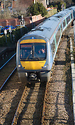 Class 170 turbostar diesel train on rail tracks, Woodbridge, Suffolk, England