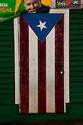 A door painted like a Puerto Rican flag in the town of San German Puerto Rico