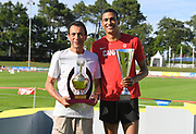 Pierce LePage (CAN), right, poses with trophy and coach Gregory Portnoy after winning the decathlon with 8,453 points during the decathlon at the DecaStar meeting, Saturday, June 23, 2019, in Talence, France. (Jiro Mochizuki/Image of Sport)