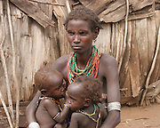 Africa, Ethiopia, Omo Valley, Daasanach tribe woman and baby