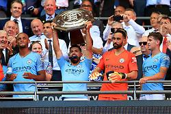 Manchester City's Sergio Aguero lifts the Community Shield trophy after the Community Shield match at Wembley Stadium, London.