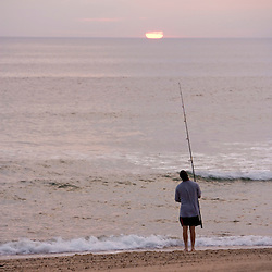 Early morning surfcasting on the beach at Cape Cod National Seashore in Massachusetts. Head of the Meadow Beach.