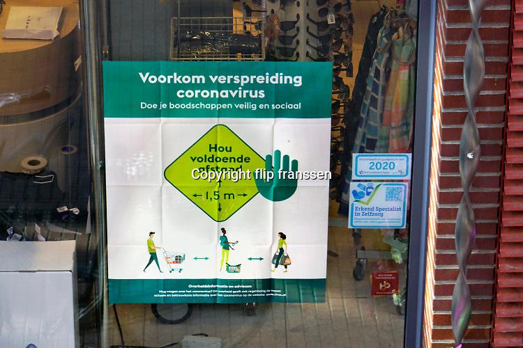 Nederland, Nijmegen, 25-3-2020 Winkels met maatregelen ivm het coronavirus. Foto: Flip Franssen