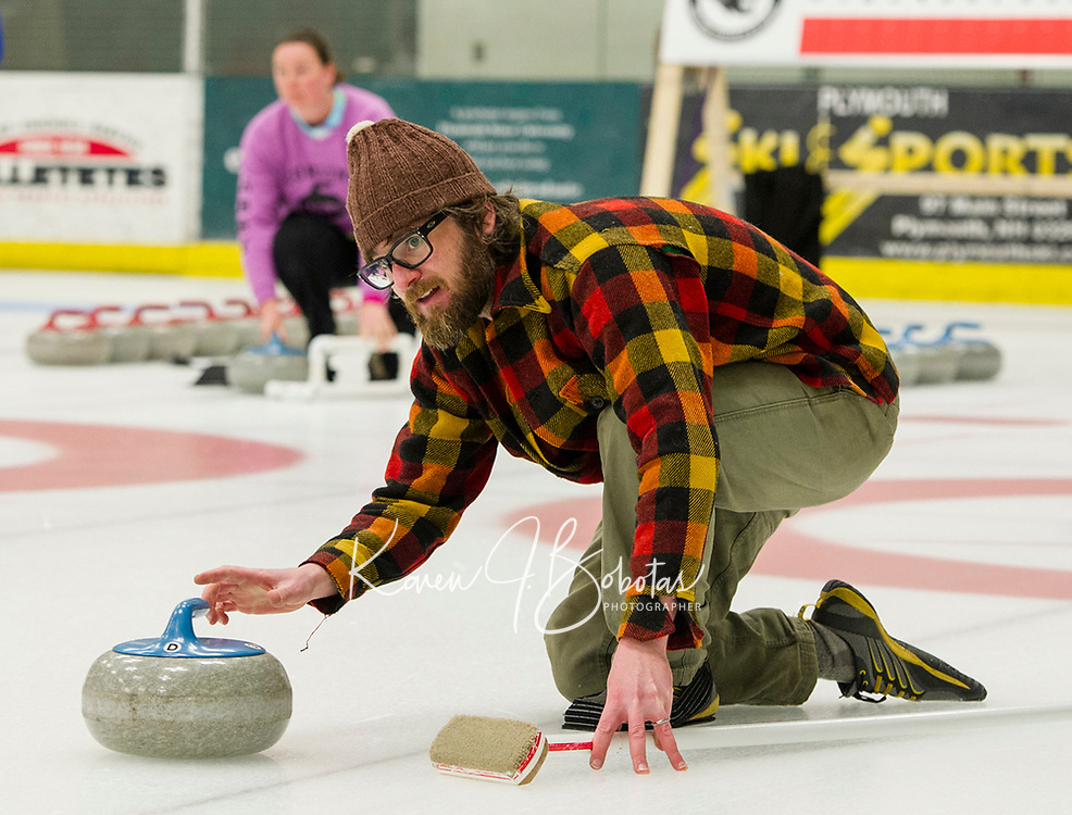"""Mike Rossi of the """"Crushers"""" delivers his stone during Curling League play at Plymouth State University Ice Arena Thursday evening.  (Karen Bobotas/for the Laconia Daily Sun)"""
