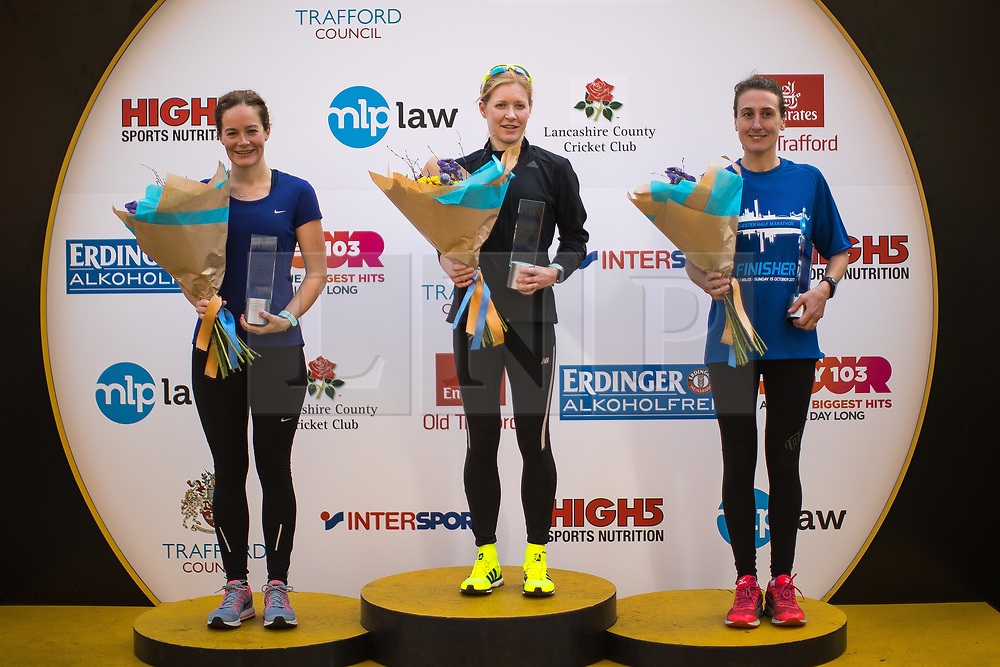 © Licensed to London News Pictures . 15/10/2017 . Manchester , UK . Women's winners L-R SARAH MACKNESS (3rd) , REBECCA HILLAND (1st) and JULIE BRISCOE (2nd) on the podiums at the end of the Greater Manchester Half Marathon in Old Trafford . Photo credit : Joel Goodman/LNP