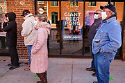 31 OCTOBER 2020 - DES MOINES, IOWA: People lined up to vote near the Polk County Auditor's Office in Des Moines. This is the last weekend of early voting before the 2020 US presidential election. The line to vote at the Polk County Auditor's Office was 5 blocks long Saturday morning and went past several bars. An elections official said that by November 3, which is Election Day, about 45 percent of the registered voters in Polk County will have already voted.     PHOTO BY JACK KURTZ