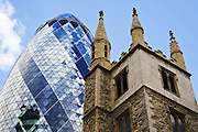 St Andrew Undershaft Church in front of the Swiss Re Building, London, England, United Kingdom