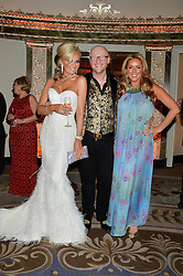 Left to right, CLAIRE CAUDWELL, JOHN CAUDWELL and CLAIRE SWEENEY at a birthday dinner for Claire Caudwell for family & friends held at The Dorchester, Park Lane, London on 24th January 2014.