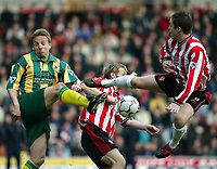 Photo: Scott Heavey<br />Southampton V West Bromwich Albion. 01/03/03.<br />Scott Oakley (right) flies in on a challenge on Larus Sigurdsson during this premiership clash at St. Marys stadium, home of Southampton.