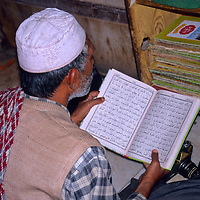 Asia, India. Man studying in mosque at Fatehpur Sikri.