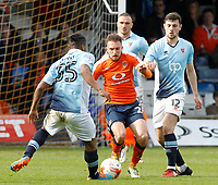 Luton Town's Lawson D'Ath battles between Blackpool's Jordan Flores & Neil Danns<br /> <br /> Photographer David Shipman/CameraSport<br /> <br /> The EFL Sky Bet League Two - Luton Town v Blackpool - Saturday 1st April 2017 - Kenilworth Road - Luton<br /> <br /> World Copyright © 2017 CameraSport. All rights reserved. 43 Linden Ave. Countesthorpe. Leicester. England. LE8 5PG - Tel: +44 (0) 116 277 4147 - admin@camerasport.com - www.camerasport.com