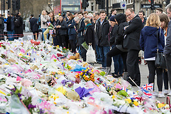 © Licensed to London News Pictures. 29/03/2017. London, UK. People leaving flowers in Parliament Squareshortly before a minute's silence, held at 14:40 exactly one week after Khalid Masood began a terrorist attack on Westminster on 22 March 2017. Photo credit: Rob Pinney/LNP