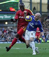 Photo: Paul Thomas.<br /> Everton v Reading. The Barclays Premiership. 14/01/2007.<br /> <br /> Andy Johnson (R) of Everton battles with Ibrahima Sonko.