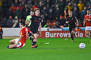 Max Power of Sunderland (27) avoids Kenny Dougall of Barnsley (4) tackle during the EFL Sky Bet League 1 match between Barnsley and Sunderland at Oakwell, Barnsley, England on 12 March 2019.