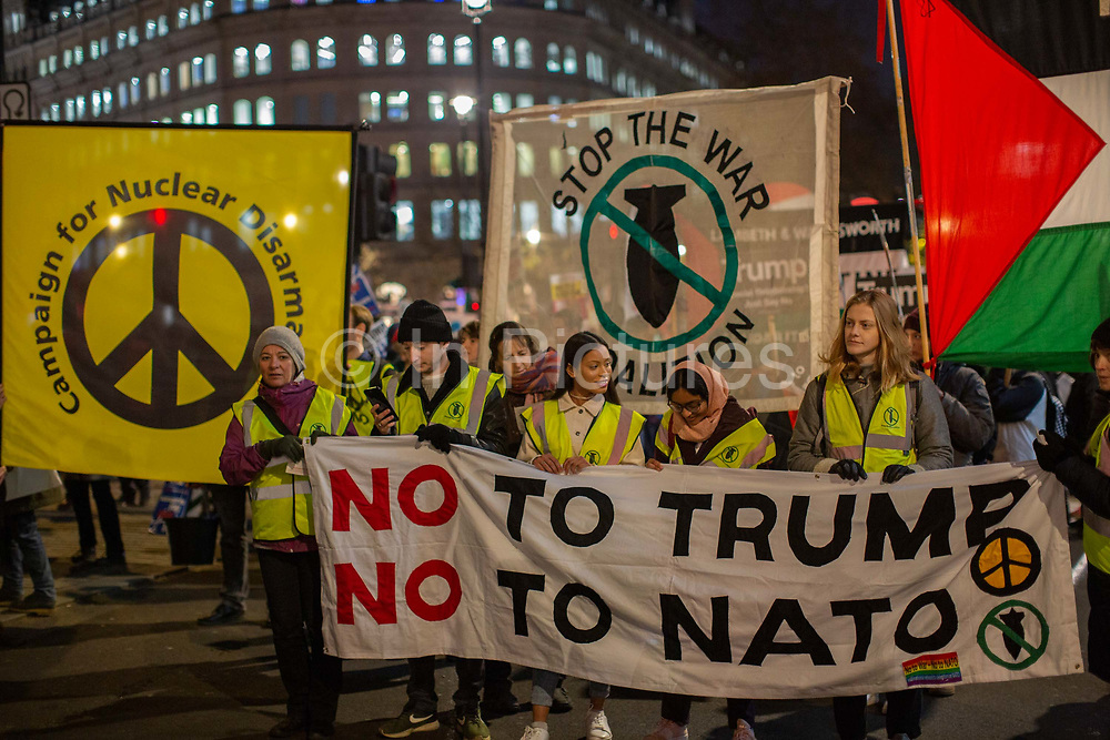 Stop Trump Coalition and CND protest against U.S. President Donald Trump UK visit to attend the NATO North Atlantic Treaty Organisation summit on the 3rd December 2019 in London in the United Kingdom. Ahead of a British national election on 12th December 2019, Stop Trump Coalition and CND, Campaign for Nuclear Disarmament organised a protest to target a banquet at Buckingham Palace where Trump will dine with the Queen and other NATO leaders. The U.K. is hosting NATO summit to mark the military alliances 70th anniversary.