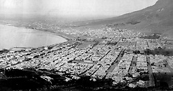 Cape Town -Table Bay-1.jpg<br />Drowsing at the foot of Table Mountain, 19th-century Cape Town has already begun its southward sprawl over the slopes of DevilÕs Peak. St StephenÕs Church on Riebeeck Square (centre foreground) was built in 1801 as a theatre, becoming a church for freed slaves in 1829, when disgruntled ex-theatregoers smashed its stained-glass windows.