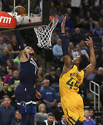 April 1, 2018 - Minneapolis, MN, USA - Minnesota Timberwolves guard Tyus Jones (1) goes for a  dunk attempt that failed in the second quarter while defended by Utah Jazz guard Donovan Mitchell (45) on Sunday, April 1, 2018 at Target Center in Minneapolis, Minn. (Credit Image: © Jeff Wheeler/TNS via ZUMA Wire)