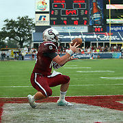South Carolina Gamecocks quarterback Connor Shaw (14) catches a touchdown pass on a trick play during the second quarter of the NCAA Capital One Bowl football game between the South Carolina Gamecocks who represent the SEC and the Wisconsin Badgers who represent the Big 10 Conference, at the Florida Citrus Bowl on Wednesday, January 1, 2014 in Orlando, Florida. (AP Photo/Alex Menendez)