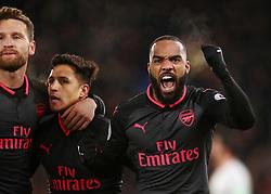 Arsenal's Alexis Sanchez celebrates scoring his side's second goal of the game with Alexandre Lacazette (right) during the Premier League match at Selhurst Park, London.