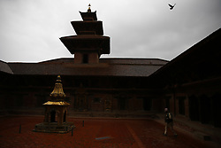 July 19, 2017 - Lalitpur, Nepal - An elderly man walks along a temple in the courtyard at Mul Chowk, one of the largest and oldest palace inside ancient Patan Durbar Square, a UNESCO World Heritage Site in Lalitpur, Nepal on Wednesday, July 19, 2017. (Credit Image: © Skanda Gautam via ZUMA Wire)