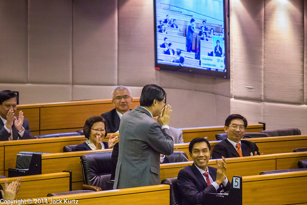 08 AUGUST 2014 - BANGKOK, THAILAND:       Newly elected Deputy President of the National Legislative Assembly (NLA) SURACHAI LIENGBOONLERTCHAI stands to thank members of the NLA after he was unanimously elected Friday. The Thai National Legislative Assembly (NLA) met Friday at the Parlimanet Building in Bangkok to elect legislative leadership. The NLA was appointed by the Thai junta, formally called the National Council for Peace and Order (NCPO), and is supposed to guide Thailand back to civilian rule after a military coup overthrew the elected government in May. There are 197 members of the NLA. Membership is tilted towards military personnel. From the Royal Thai Army 40 members are Generals, 21 are Lt. Generals and 7 are Major Generals. From the Royal Thai Air Force 17 are Air Chief Marshals and 2 are Air Marshals. From the Royal Thai Navy, 14 are Admirals and 5 are Vice Admirals. There are also 6 Police Generals and 3 Police Lt. Generals. There are 187 men in the NLA and only 10 women.  PHOTO BY JACK KURTZ